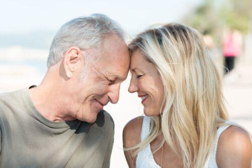 Elderly couple on the beach - edicare couple